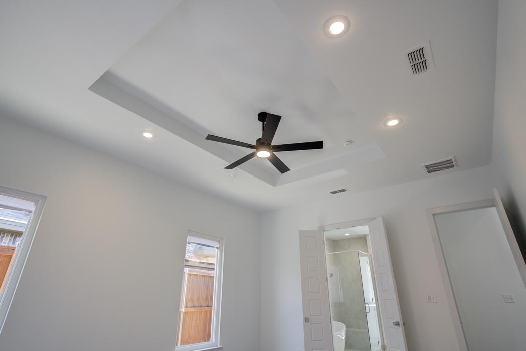 Spacious master bedroom with special ceiling.