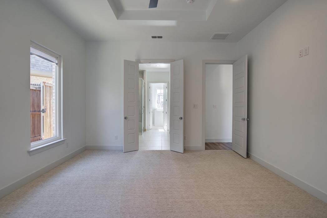 Spacious master bedroom in home in Lubbock, Texas.