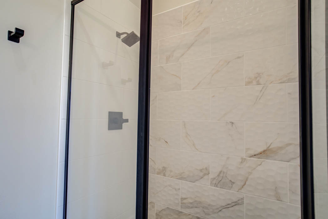 Glass shower in master bath in new home for sale in Lubbock, Texas.