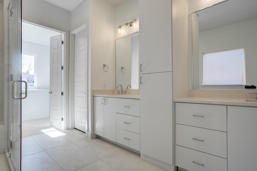 View of dual vanities in spacious, modern master bath in Lubbock home.
