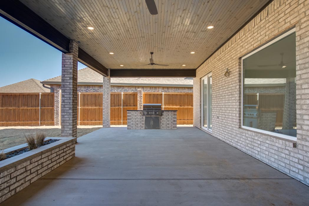 Spacious covered patio area in custom Lubbock, Texas home.
