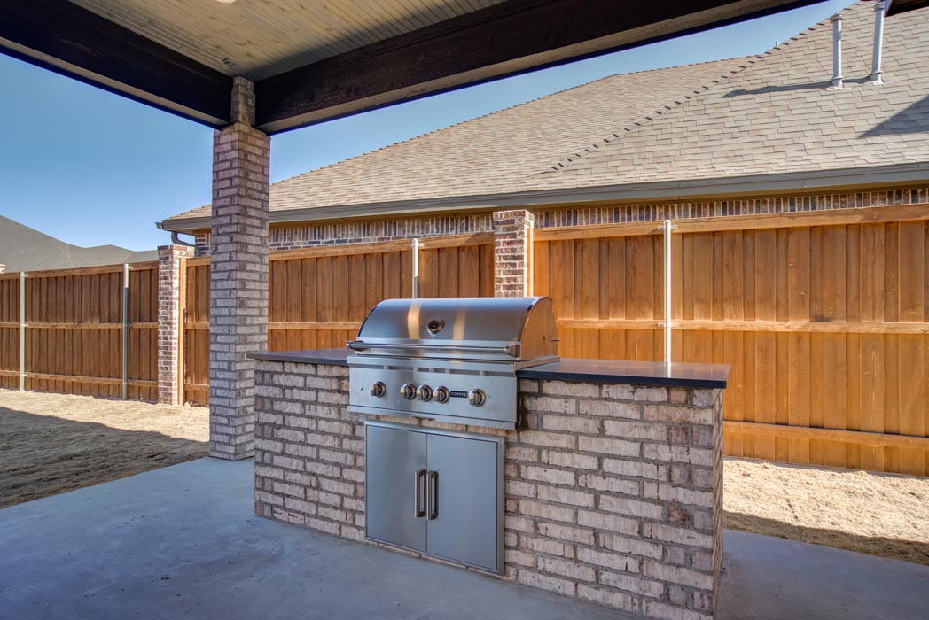 View of built-in grilling area of backyard patio.