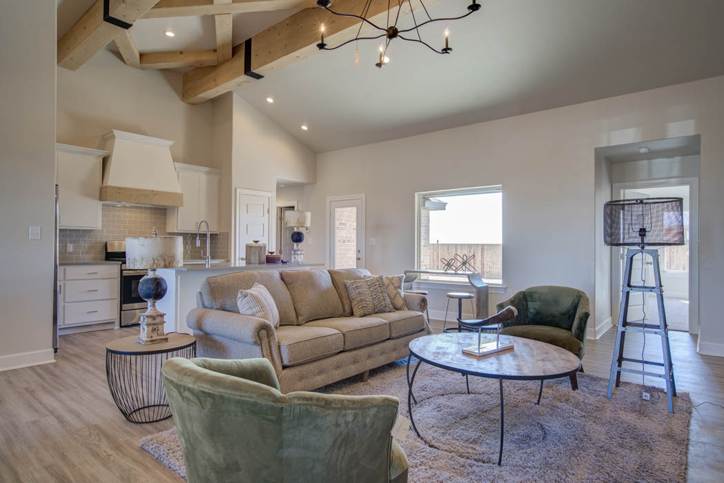 Kitchen and living room in custom home by Sharkey Custom Homes in West Texas.