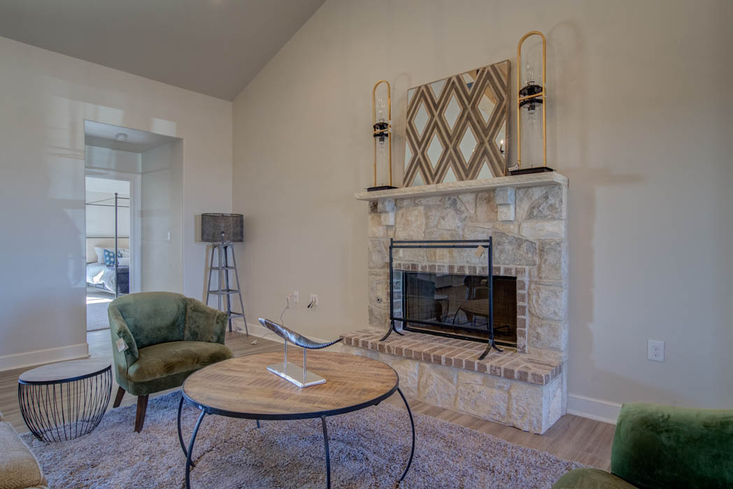 Beautiful Living Area With Fireplace in custom home in Lubbock.