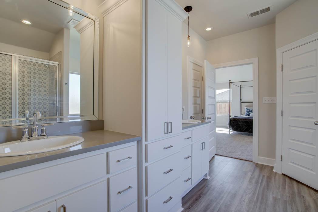 Vanity in bath in custom Lubbock home.