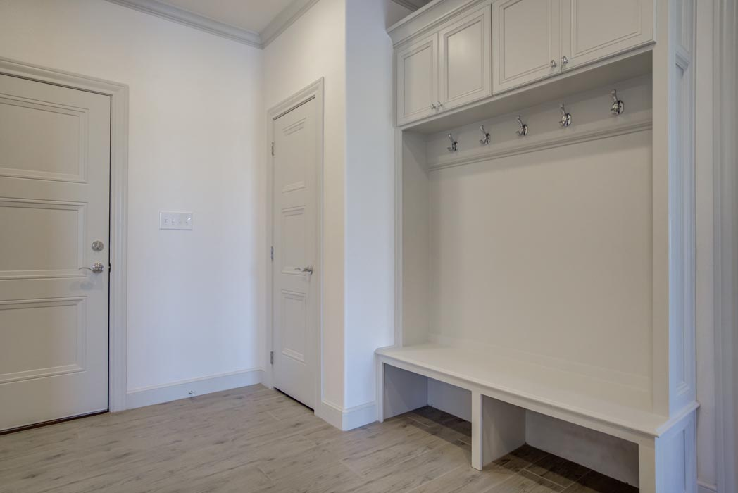 Example of spacious laundry-mud room in new home built by Sharkey Custom Homes in Lubbock, Texas.