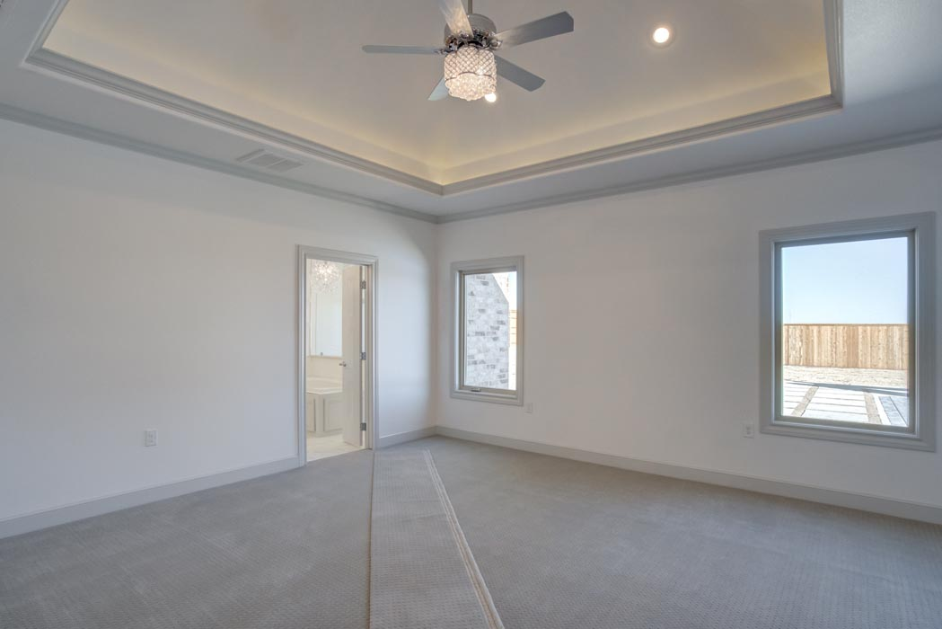 Spacious master bedroom with beautiful vaulted ceiling in new Lubbock, Texas home.