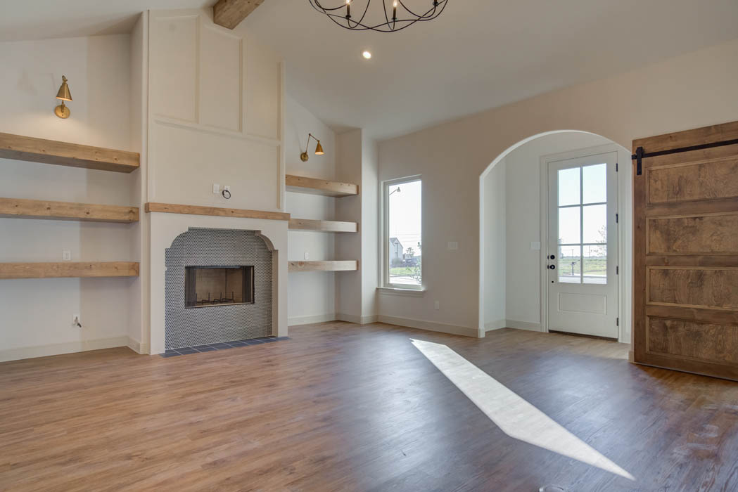 Beautifully detailed living area with arched window nooks in home for sale in Lubbock.