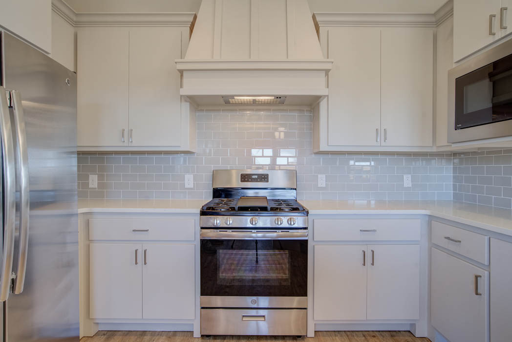 Detail of kitchen in house by Sharkey Custom Homes.