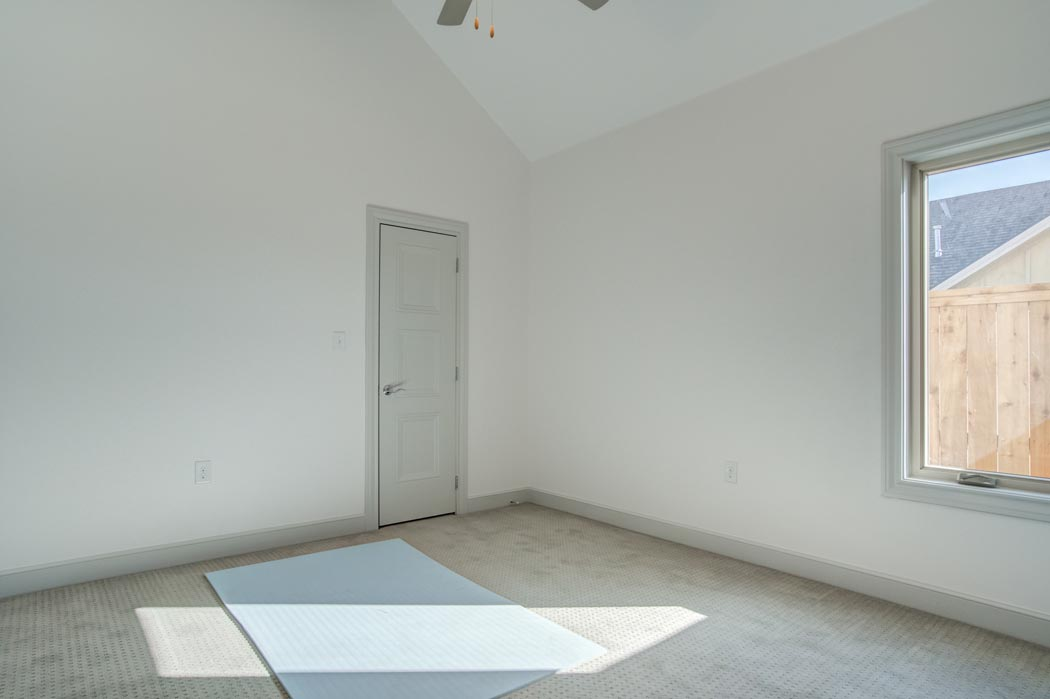 Bedroom with sunny windows in new Lubbock home.