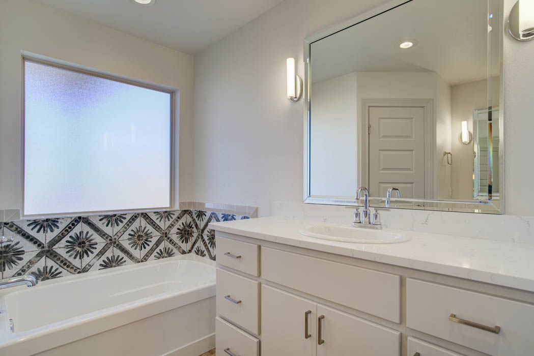 Vanity in bath in custom Lubbock home.