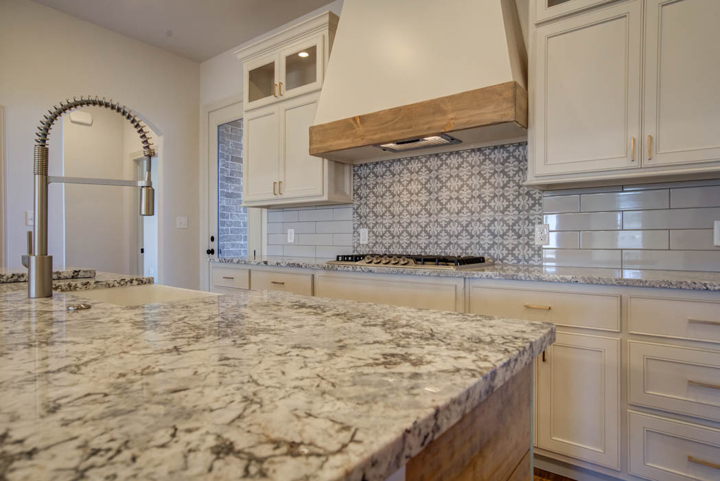 Spacious kitchen island with granite countertop in home for sale in Lubbock.