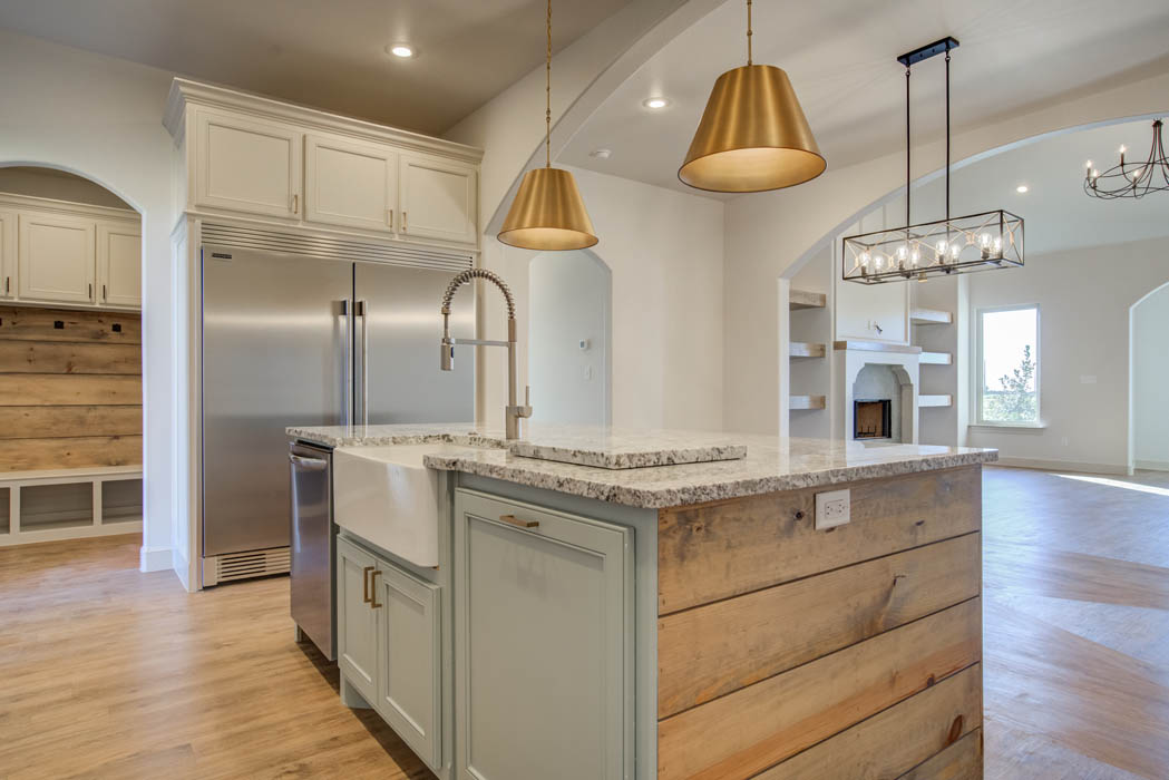Wonderfully appointed kitchen in new Lubbock area home with stainless steel refrigerator.