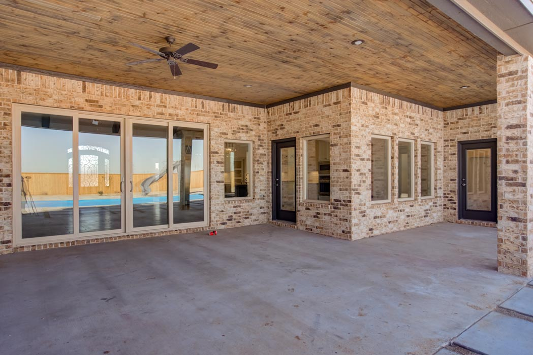 Spacious outdoor back patio of new home built in Lubbock, Texas.