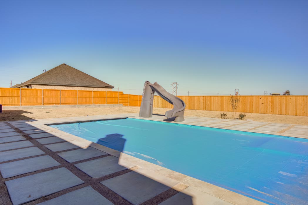 Beautiful outdoor backyard with pool in home built by Sharkey Custom Homes in Lubbock.
