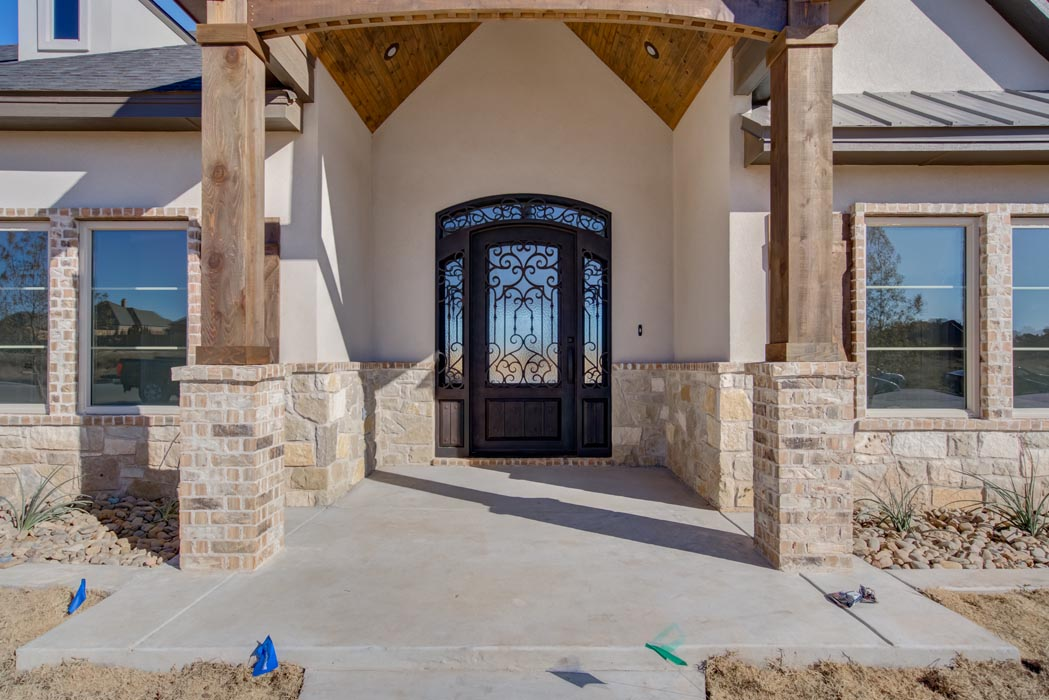 Closer view of entry exterior of new home in Lubbock.
