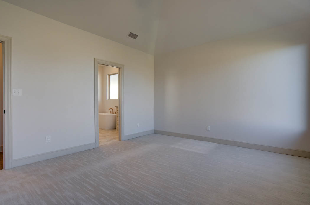 Spacious master bedroom in Lubbock area home for sale.
