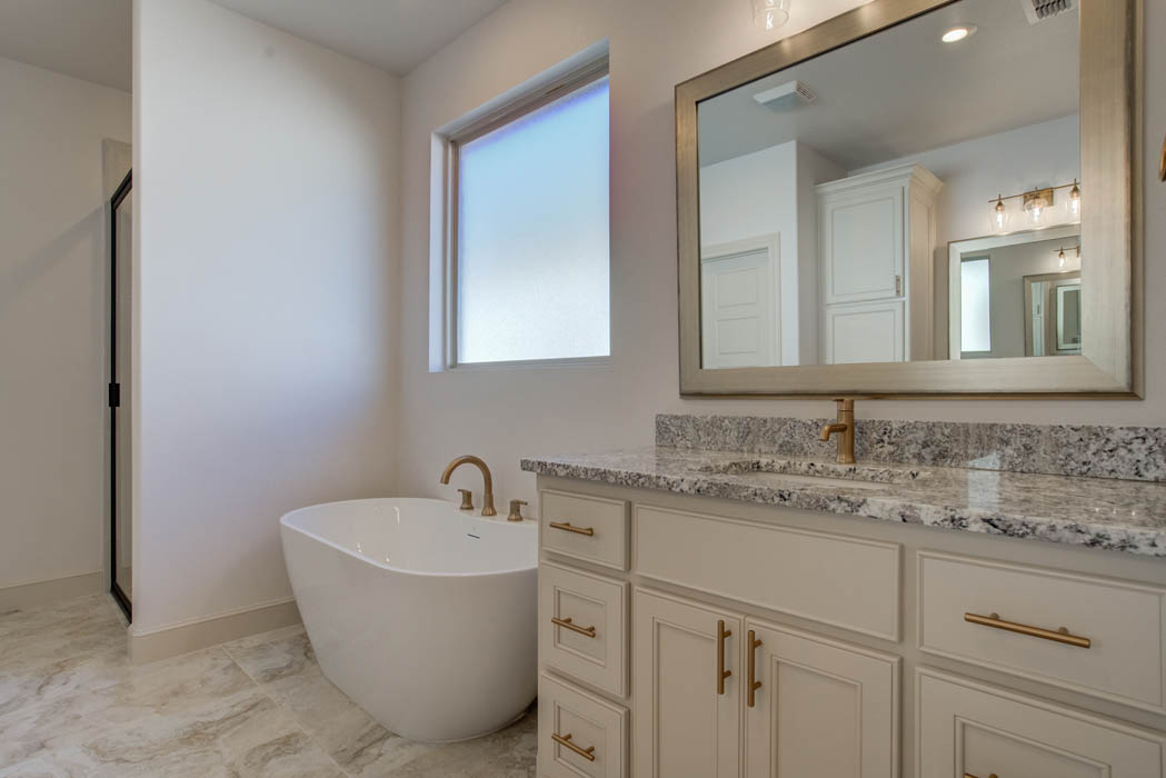 Master bath in new home for sale in Lubbock featuring specialty tub.