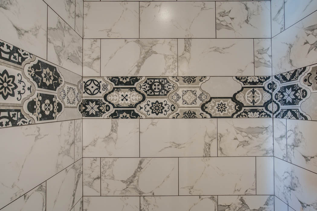 Detail of tile work in beautiful bathroom in home for sale in Lubbock, Texas.