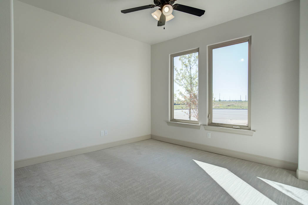 Spacious guest bedroom in new home for sale in Lubbock.