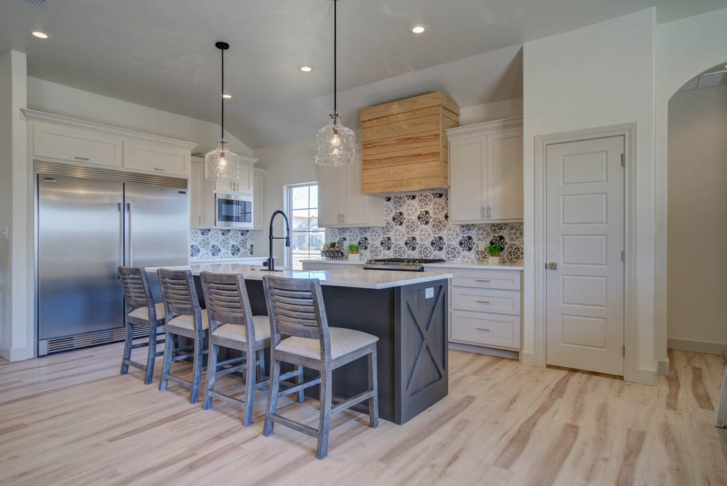Kitchen with countertop bar in custom home by Sharkey Custom Homes in West Texas.