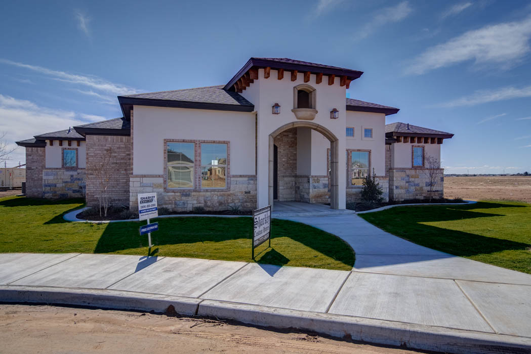 Remarkable home exterior with subtle Mediterranean influences, by Sharkey Custom Homes in Lubbock.