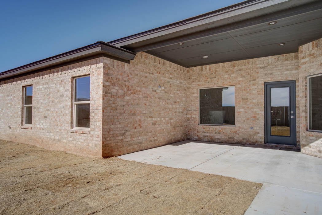 Covered patio area in Lubbock, Texas custom home.