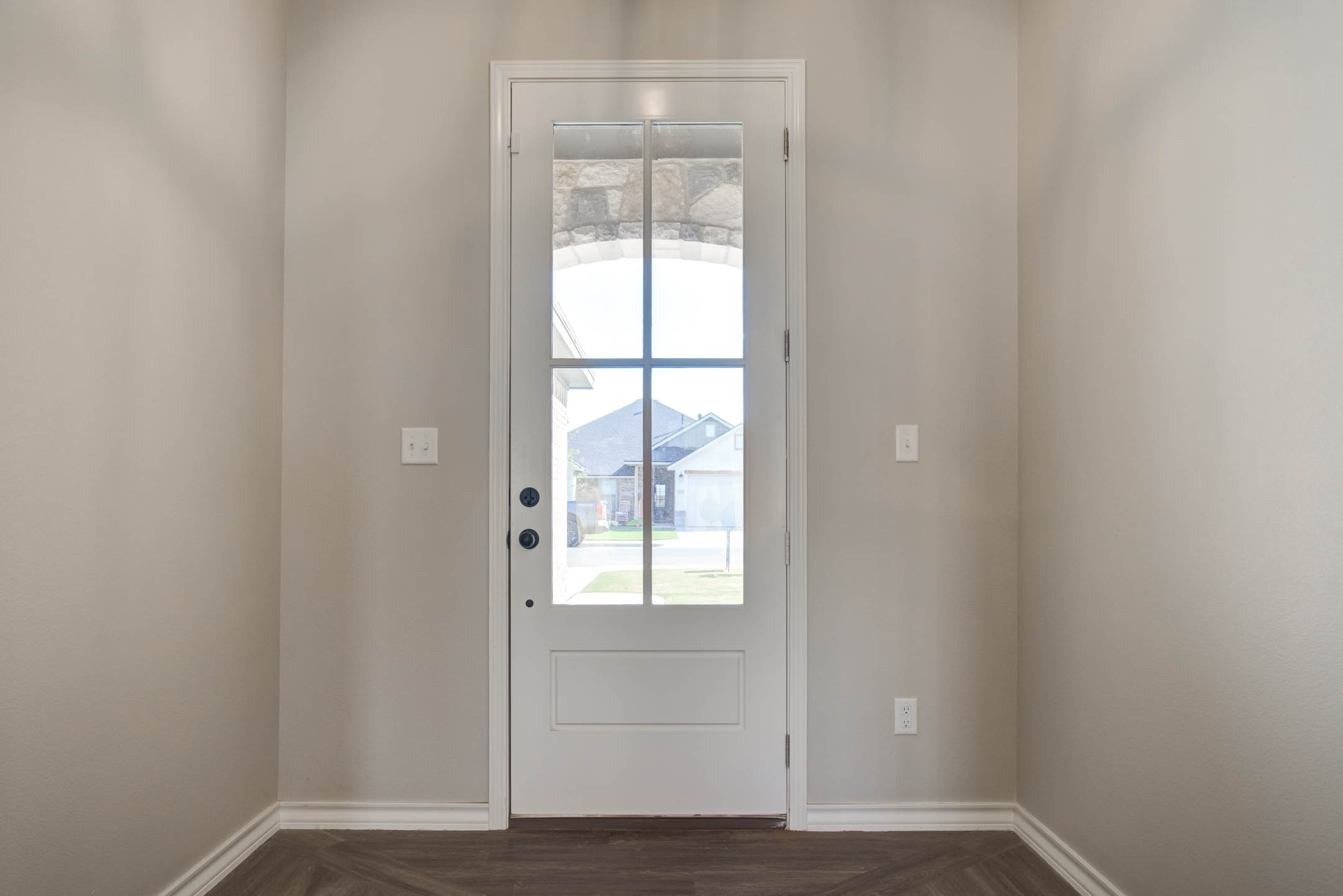 Entry door & foyer of new home for sale in Lubbock, Texas.