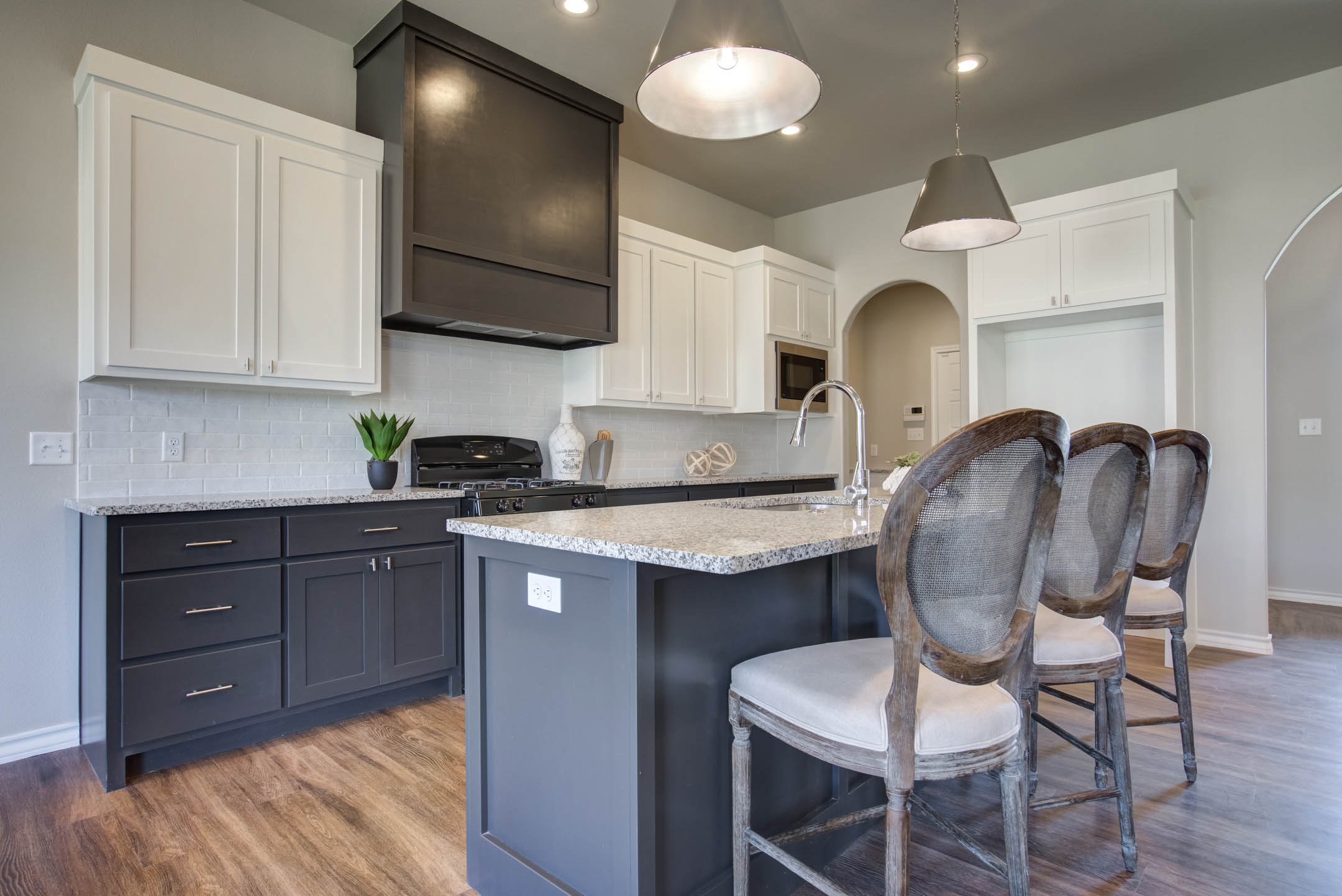 Bar island of kitchen in new home for sale in Lubbock, Texas.