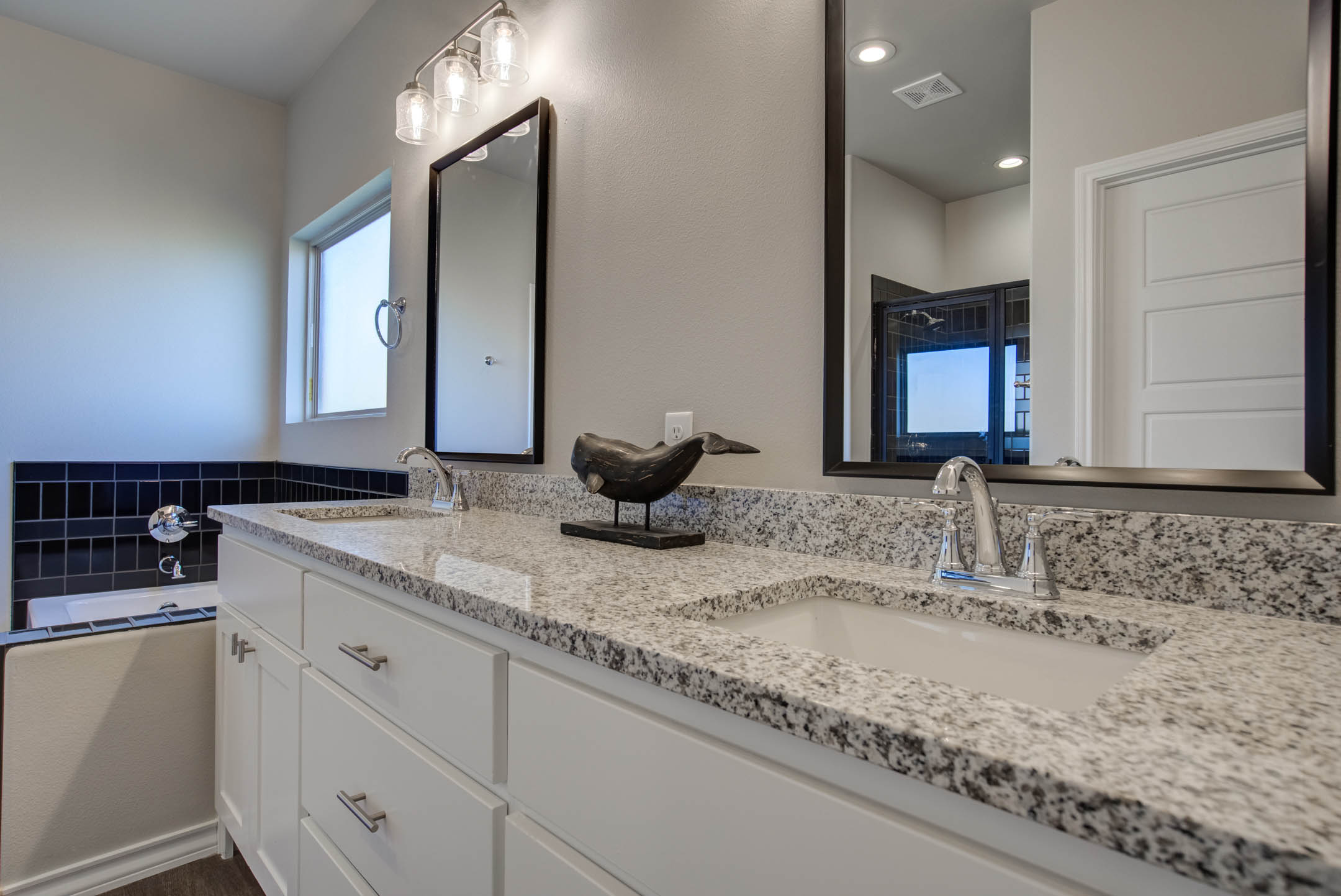 Spacious vanities in master bath of new home for sale in Lubbock.