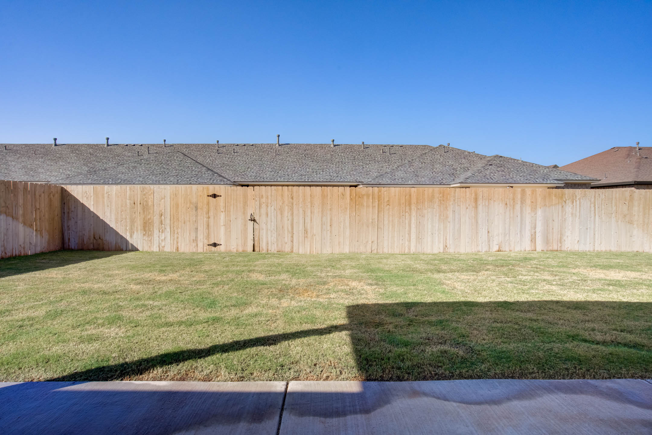 Spacious backyard of new home for sale in Lubbock, Texas.