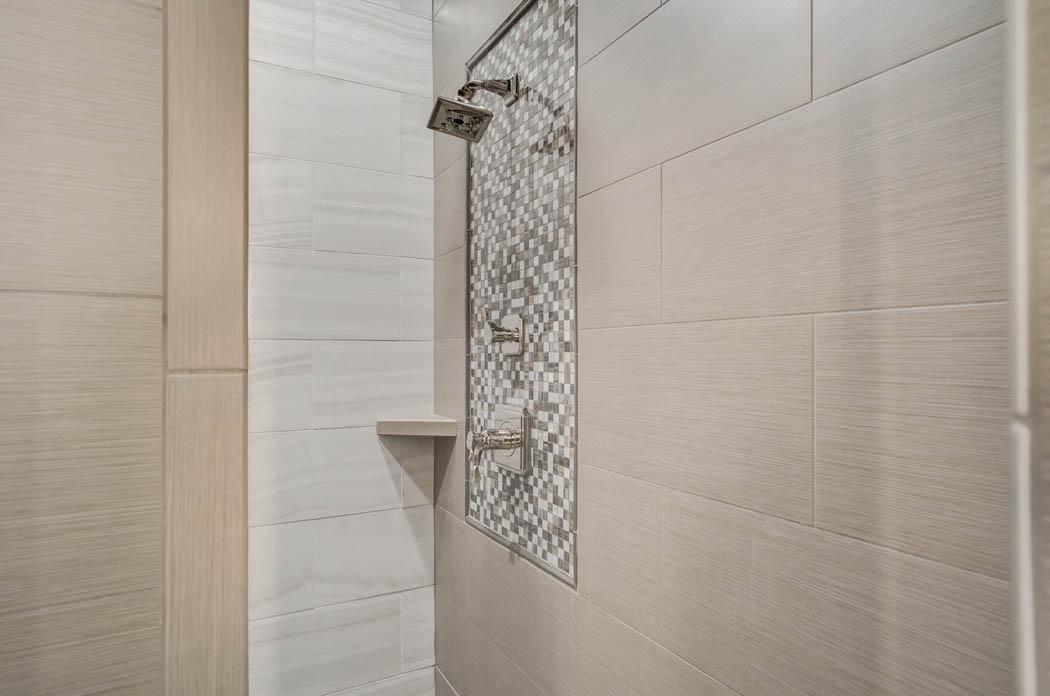 Detail of shower tile treatment in custom home built by Sharkey Custom Homes of Lubbock.