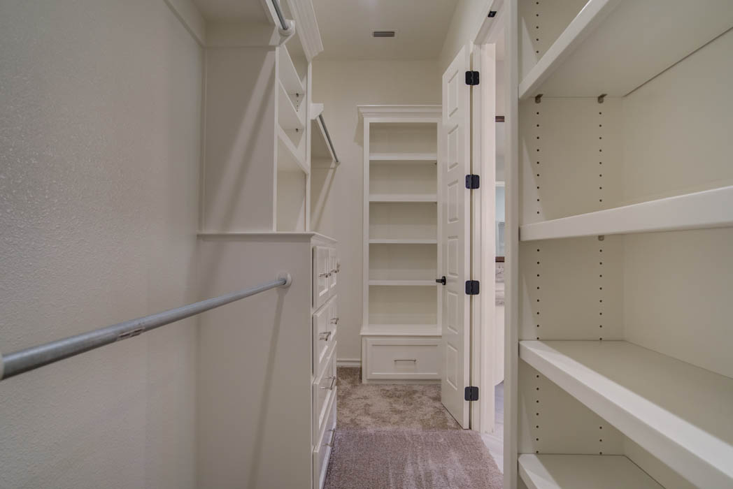 View of spacious master closet in Lubbock, Texas custom home.