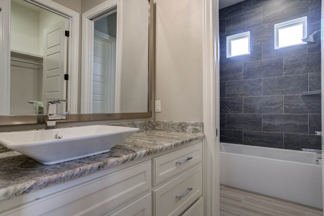 Specialty vanity and sink in custom home.
