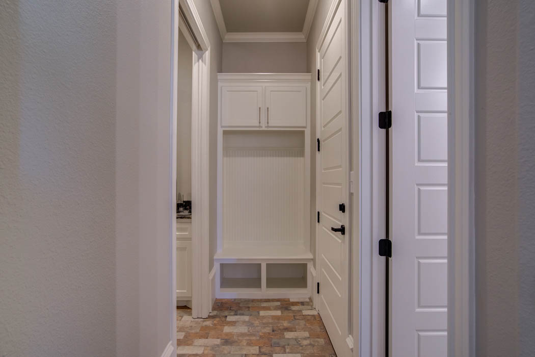 Laundry room entrance in custom Lubbock home by Sharkey Custom Homes.