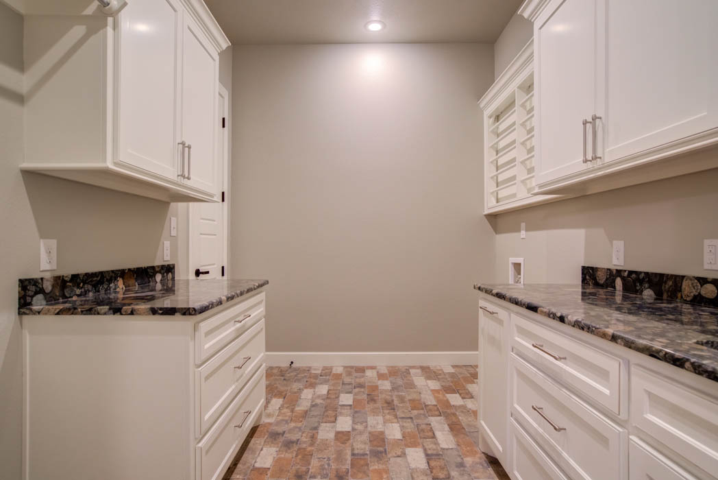 Spacious laundry room in custom Lubbock, Texas home.