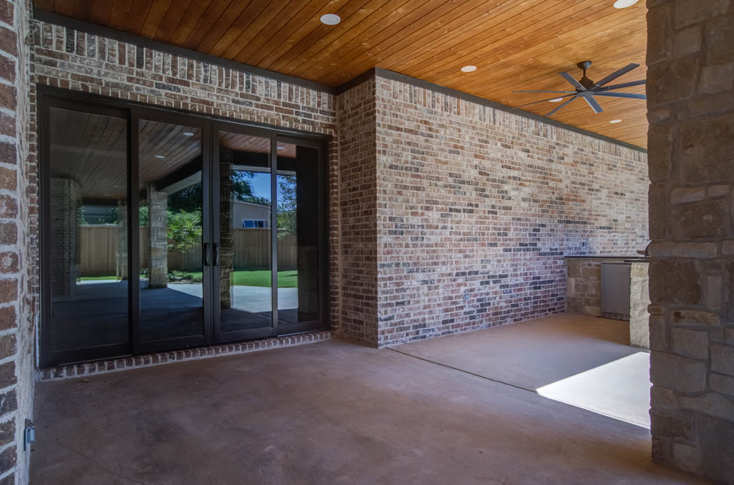 Spacious outdoor patio with large doors in custom home in Tech Terrace, Lubbock, Texas.