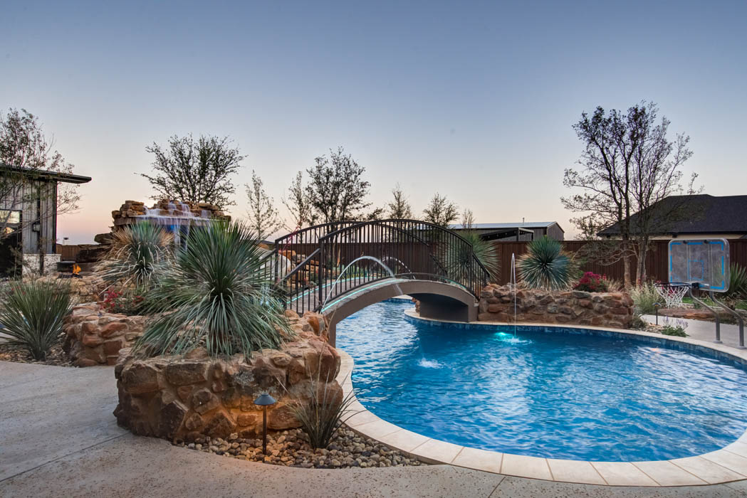 Beautiful swimming pool with amazing landscaping in Lubbock custom home.