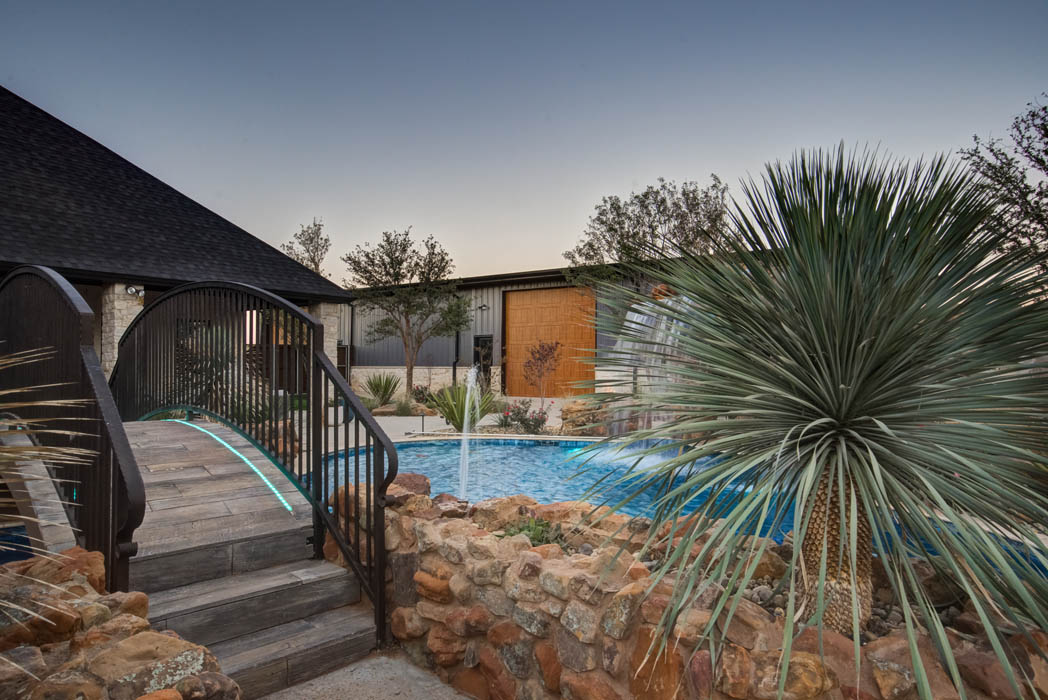 Enjoyable outdoor living space with lounging areas and a beautiful pool, in home near Lubbock.