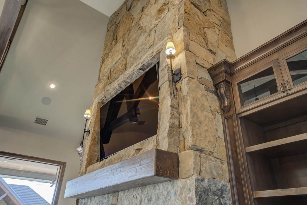 Fireplace in living area in beautiful custom home by Sharkey Custom Homes, near Lubbock, Texas.