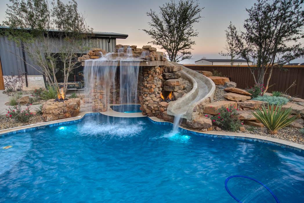 Wonderful pool with stone slide in custom home near Lubbock, Texas.