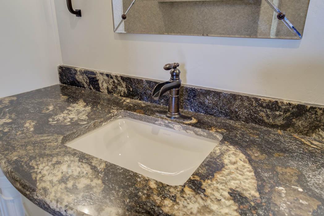 Detail of basin in beautiful bath by Sharkey Custom Homes, Lubbock, Texas.