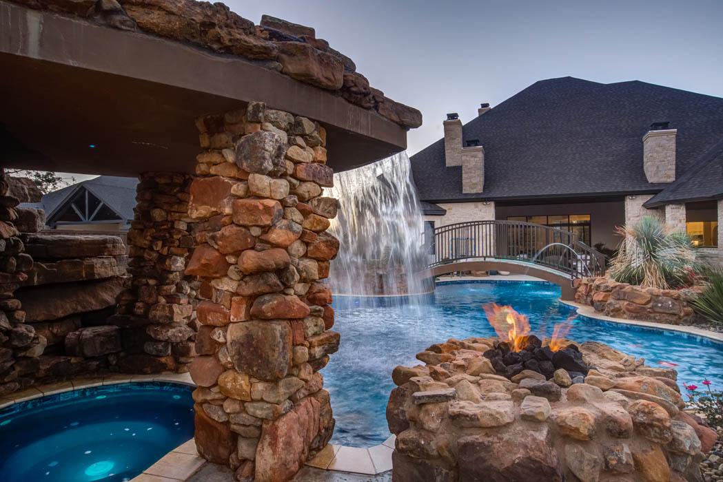 Hot tub area in beautiful swimming pool area of custom home.