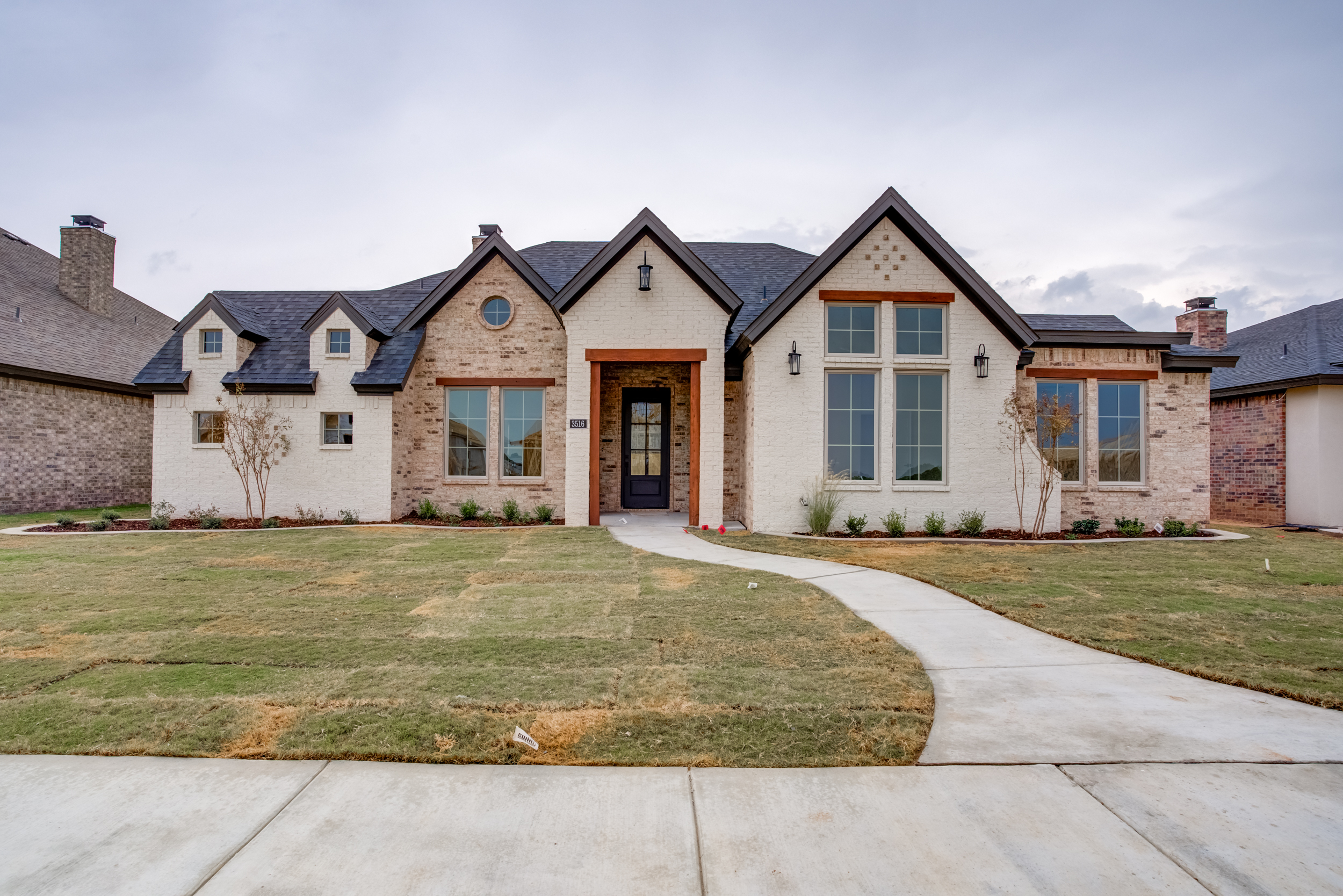 Beautiful new home for sale in Lubbock, Texas, with interesting design and brick exterior.