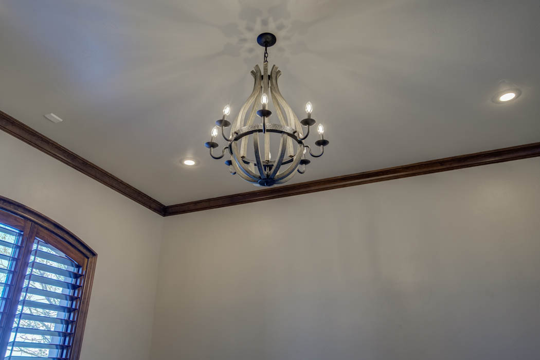 Ceiling and lighting fixture treatment in custom home near Lubbock.