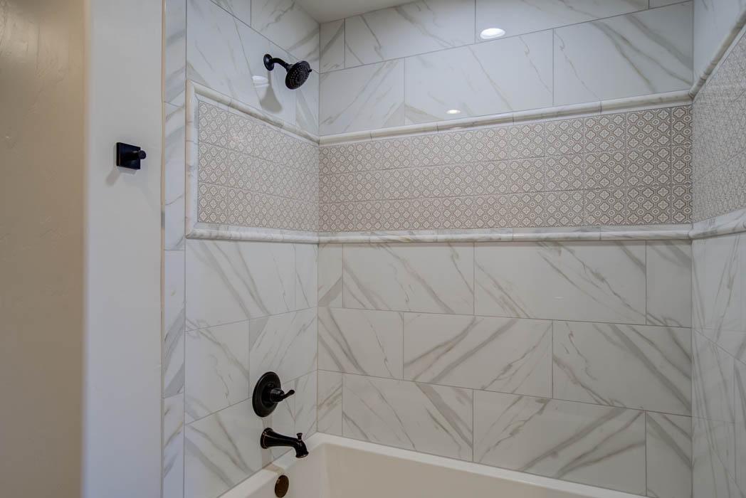 Distinctive tile work in bath of custom home near Lubbock, Texas.