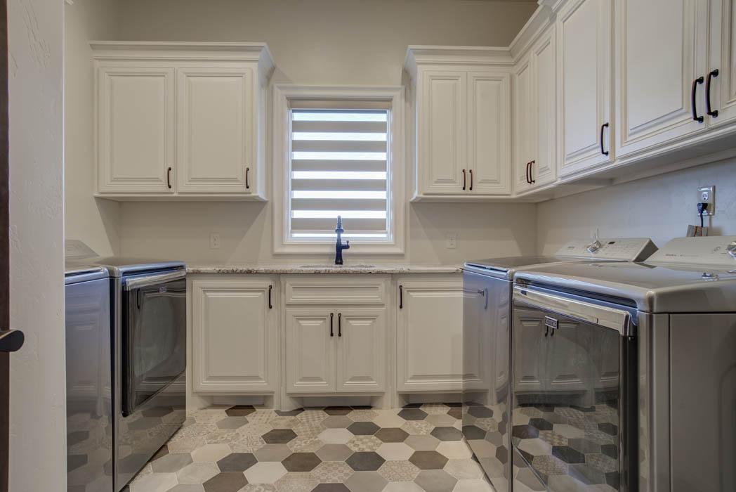 Laundry room in custom Lubbock home by Sharkey Custom Homes.
