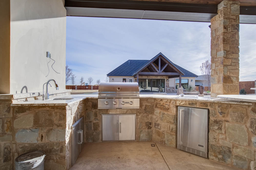 Detail of outdoor kitchen on patio of beautiful custom home near Lubbock, Texas.