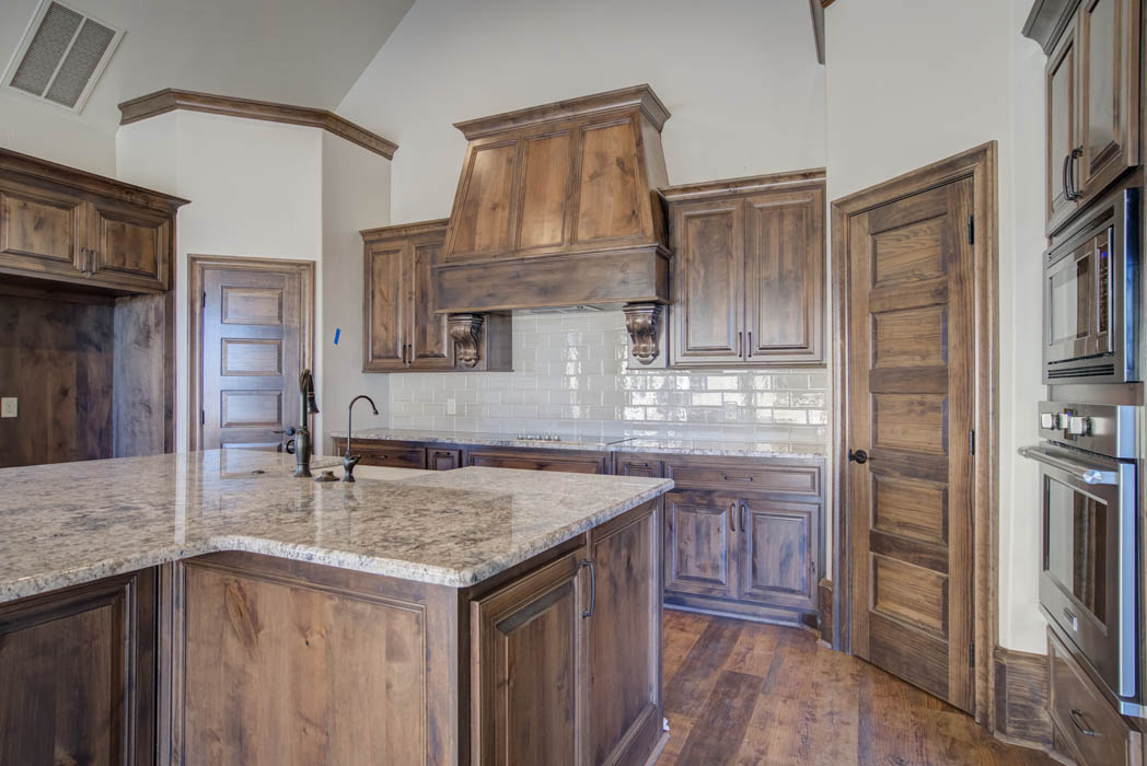 Kitchen island in beautiful custom home by Sharkey Custom Homes, near Lubbock, Texas.