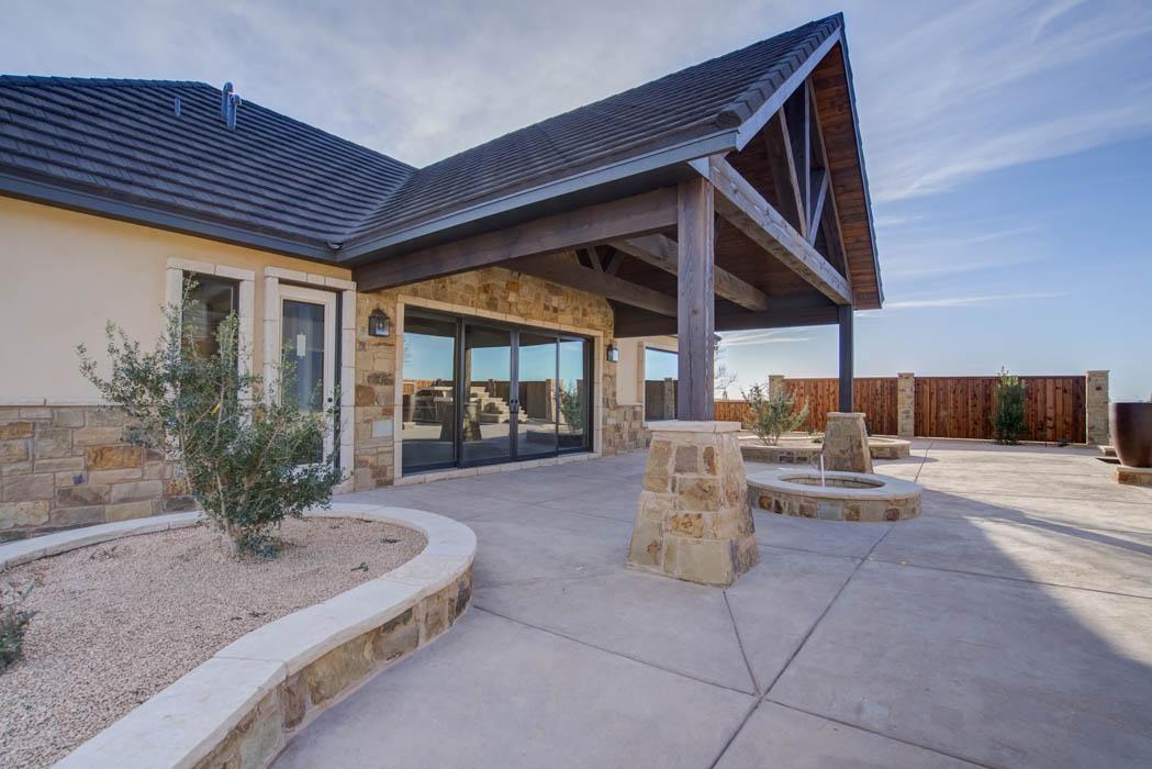 Detail of exterior circular drive of beautiful custom home by Sharkey Custom Homes, near Lubbock, Texas.